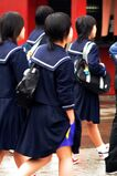 Japanese student with her hand in their pocket