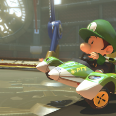 Baby Luigi driving across the clock.