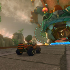 Baby Luigi about to enter Gobblegut's mouth.