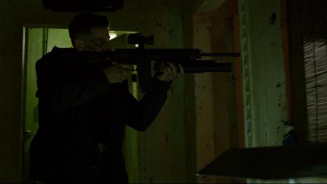 File:Punisher uses his gun.png