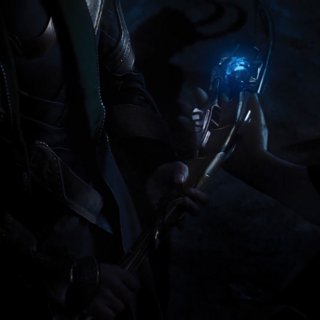 The Other giving Loki the Scepter