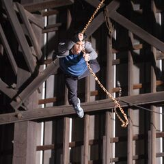 Peter swinging from a chain.