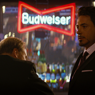 Tony Stark approaches General Ross in a bar