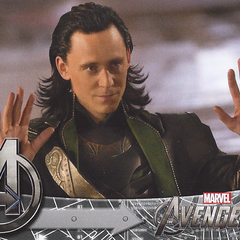 Loki surrenders to Iron Man and Captain America.