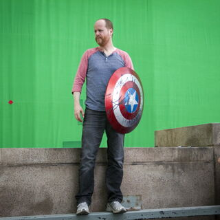 Joss Whedon on set with Captain America's Shield.