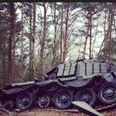 Set photo of a destroyed Tank on set in Hampshire Woods, UK