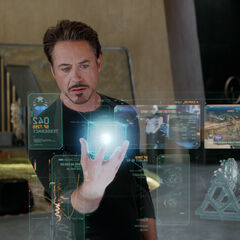 Stark reviewing a holographic data summary of the cosmic cube.