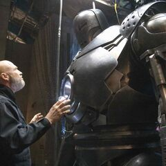 Stane admires his own suit.