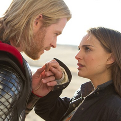 Thor kisses Jane Foster's hand.