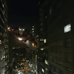 Iron Man flying through the city.