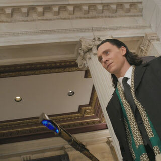Loki using the Scepter as a Cane.