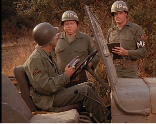 File:Ep. 10x7 - Two MPs stop Klinger with stolen camera.jpg
