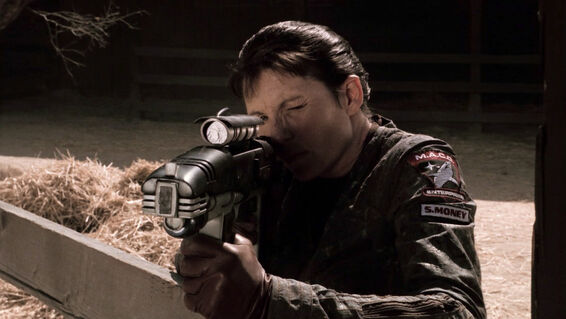 File:S Money aiming a particle rifle.jpg