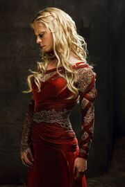 Morgause in red dress