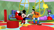Mickey gives goofy a stinky shoe
