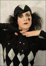 "Dee Plume as a clown for her music video ""Tears""."