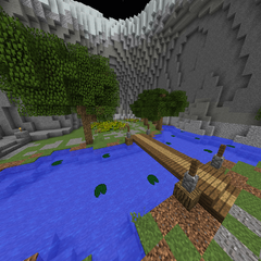The river and wheat field in front of the Wolf Spawn.