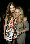103597808-miranda-kerr-and-guest-at-the-victorias-gettyimages