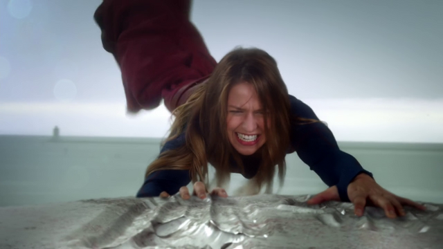 File:Supergirl pulling the ship away from the National City Port.png