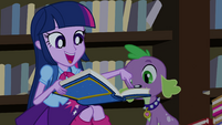 Twilight pointing to photo of human Main Five