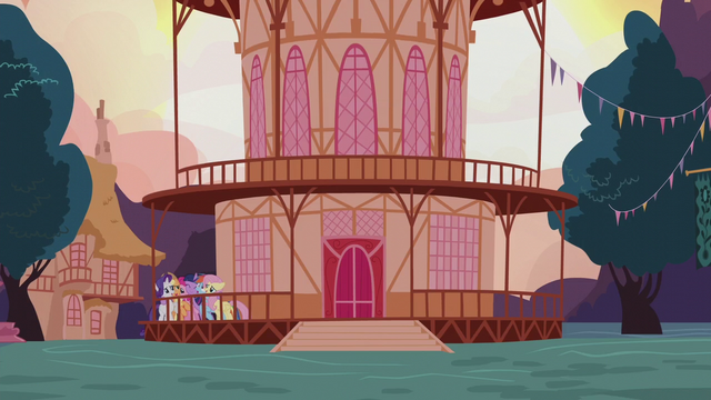 File:Mane Six hugging outside town hall S5E9.png
