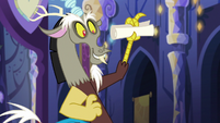 Discord holding a rolled-up list S6E17