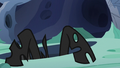 Changeling climbing out of a hive hole S6E26.png