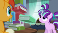 Filly Starlight levitates book out; looks up at book tower S5E26.png