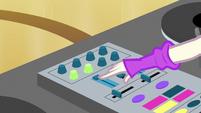 DJ Pon-3 operating the audio mixer EGS1