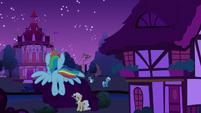 Rainbow flying toward Ponyville town hall S6E15