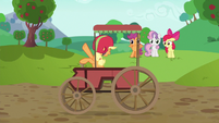 Applejack coasts past screen in traditional cart S6E14