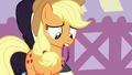 Applejack looking at purple band in her mouth S7E9.png