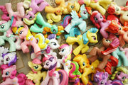 Assorted molded pony toys