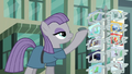 Maud shows Boulder a postcard S6E3.png