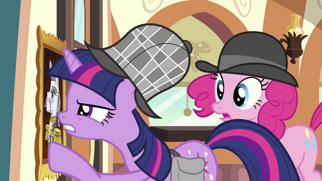 File:Twilight looking at portrait closely S2E24.png