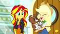 Applejack happily holding Winona SS7.png