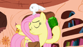 Fluttershy holding a gem S3E11 (Promo).png