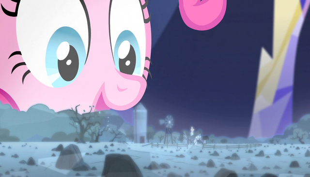 File:Pinkie looks at hologram of rock farm S5E1.png