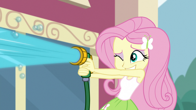 File:Fluttershy spraying water from a hose EGS1.png