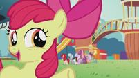Apple Bloom gestures toward other ponies S5E18