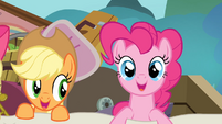 Applejack and Pinkie Pie emerges from the sheet S4E09