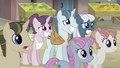 Sugar Belle, Party Favor, and Night Glider nervous smiles S5E02.png