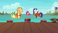 AJ, Pinkie, and Rarity a few feet away from the docks S6E22.png