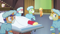 Applejack and surgeon ponies looking shocked S6E23.png