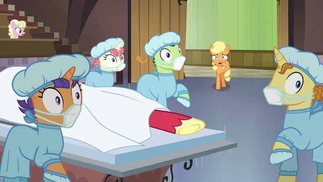 File:Applejack and surgeon ponies looking shocked S6E23.png