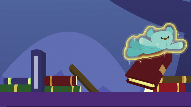 File:Blue teddy bear knocking over books S7E3.png