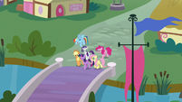 Mane Six walking over a bridge S5E19