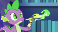 Spike blowing fire on yet another scroll S6E15