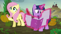 Twilight Sparkle taking extensive notes S5E23