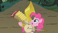 Pinkie gesturing to her instruments S1E10.png